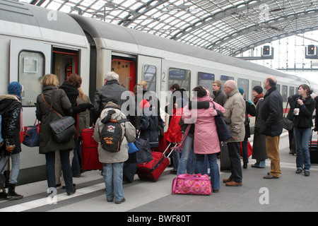 Passengers get on the train at main station, Berlin, Germany - Stock Photo