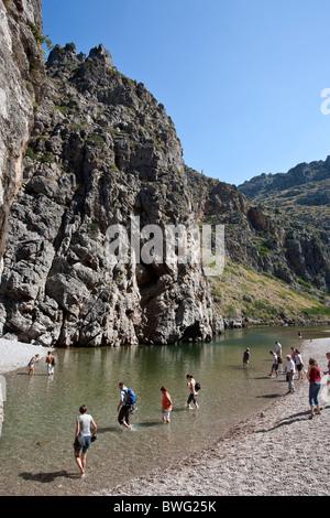 Tourists crossing Torrent de Pareis. Sa Calobra. North of Mallorca Island. Spain - Stock Photo
