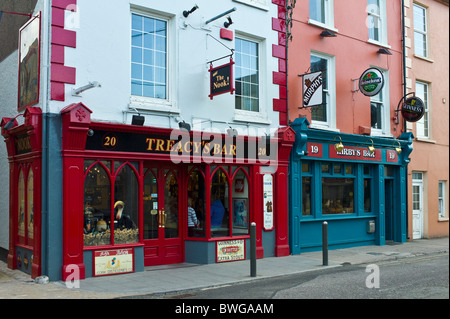 Treacy's Bar and Kirby's Bar in High Street, Youghal, County Cork, Ireland - Stock Photo