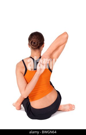 Woman doing yoga exercise called Cow Face Pose, sanskrit name: Gomukhasana - Stock Photo