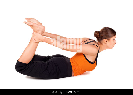 Woman practicing yoga exercise called Bow Pose Sanskrit name: Dhanurasana - Stock Photo