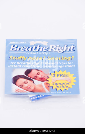 A pack of Breathe Right nasal strips to stop snoring and relieve stuffy noses on a white background - Stock Photo