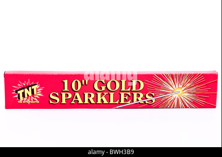 A pack of gold sparklers ( fireworks ) on a white background - Stock Photo