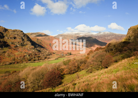 Nant Gwynant, Gwynedd, North Wales, UK. View along the valley to distant Glyder mountains in Snowdonia National Park in autumn