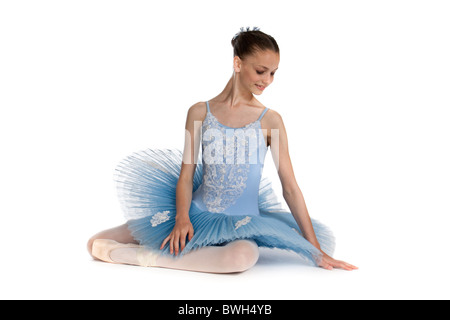 Studio shot of beautiful young ballet dancer in blue tutu, against white background - Stock Photo