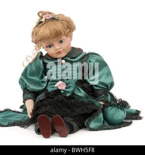 Vintage porcelain doll - Stock Photo