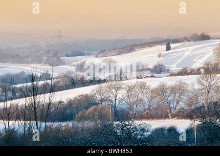Picturesque winter snow scene at sunrise taken with sunlit landscape at Overscourt near Siston, Bristol, South Gloucestershire - Stock Photo