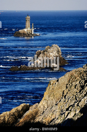 View from the Pointe du Raz on rocks and lighthouse, Finistere, Brittany, France, Europe - Stock Photo