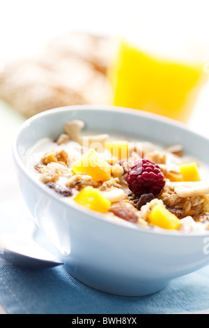 yogurt with cereal and fruit - Stock Photo