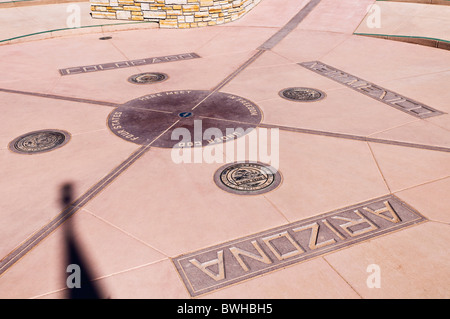 Geographical marker at Four Corners Monument, New Mexico - Stock Photo