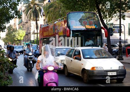 Sightseeing bus, tourist bus, traffic, palm trees, Palermo, Sicily, Italy, Europe - Stock Photo