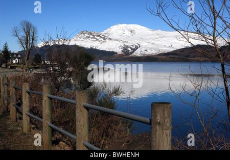 Snow capped Ben Lomond on the banks of Loch Lomond - Stock Photo