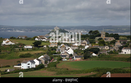 The town of Perranuthnoe, Cornwall, South West England, UK in the foreground and St Michael's Mount near to Penzance - Stock Photo
