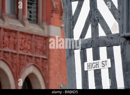 Abstract image consisting of High Street sign on Tudor building and the city hall of Stratford upon Avon, England. - Stock Photo