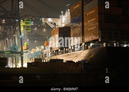 Container Ship Being Unloaded in Dock, Port of Antwerp - Stock Photo