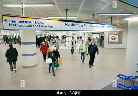 Kings Cross St. Pancras underground tube station on Euston Road, London. New entrance exit foyer, travellers and - Stock Photo