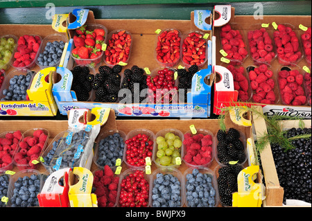 Fruit like berries on display in market stall, Dolomites, Italy - Stock Photo