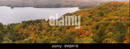 Panoramic aerial fall nature scenery of the Lake of Bays and hills covered with thick carpet of mixed colorful forest - Stock Photo