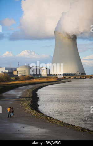 Children Playing Near Nuclear Cooling Towers of Doel - Stock Photo
