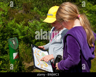 Two young girls on an orienteering course in the Peak District Derbyshire England UK - Stock Photo