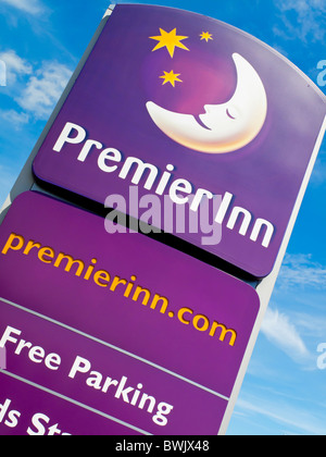 Premier Inn sign outside a budget hotel part of a chain in the UK owned by Whitbread - Stock Photo