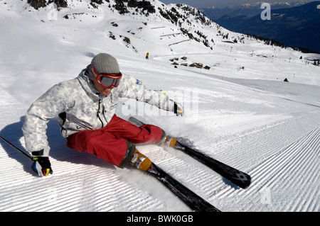 Skier on snowy ski slope in the sunlight, Zillertal, Tyrol, Austria, Europe - Stock Photo