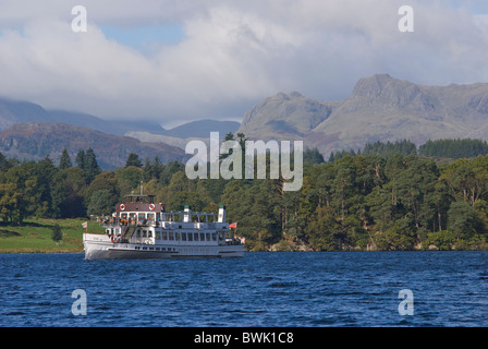 Steamer cruising on Lake Windermere, with Langdale Pikes behind, Lake District National Park, Cumbria, England UK - Stock Photo