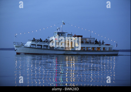 Ferryboat on Lake Chiemsee in the evening, Fraueninsel, Chiemgau, Bavaria, Germany - Stock Photo