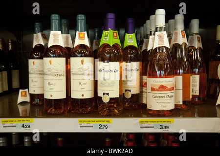 Bottles of french Rose wine on the shelves for sale in a french supermarket, Meaux, Ile de France Northern France - Stock Photo