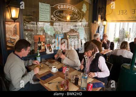 People Sitting In A Traditional French Cafe Au Rocher De Cancale On