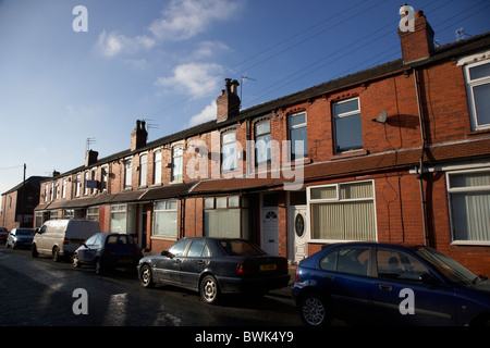 row of 2up 2down modernised victorian red brick terraced houses in manchester uk - Stock Photo