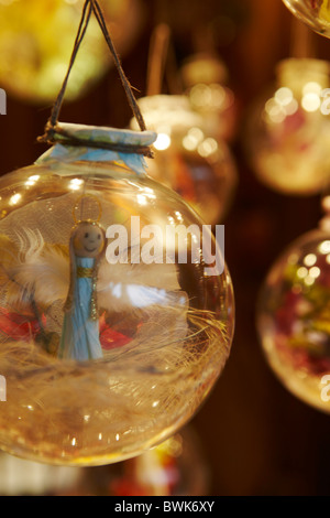 glass Christmas bauble decorations fairy inside - Stock Photo