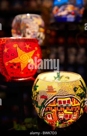 Christmas decorated glass candle holders - Stock Photo