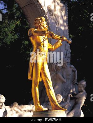Gilded statue of Johann Strauss in City Park, Vienna, Austria - Stock Photo
