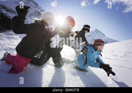 Children playing in snow, Galtuer, Paznaun valley, Tyrol, Austria - Stock Photo