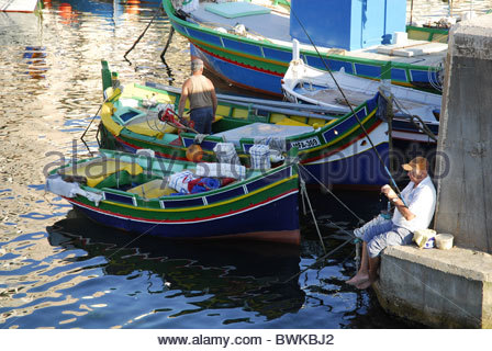Fishing boats in the harbour, Marsalforn Bay, Marsalforn, Gozo Island, Malta, Mediterranean, Europe - Stock Photo