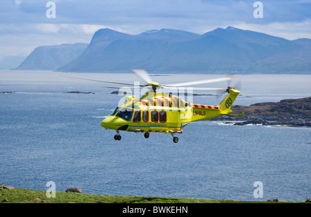 Rescue action with a air-ambulance.Runde,Norway - Stock Photo