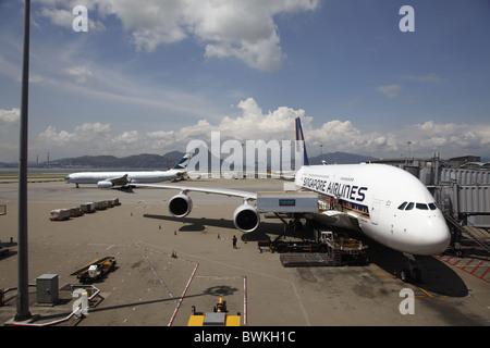 China, Hong Kong International Airport at Chek Lap Kok, Singapore Airlines Airbus A380 Aircraft Docked at Terminal - Stock Photo