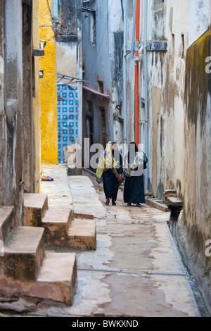 Women in an alley, Lamu Island, Kenya - Stock Photo