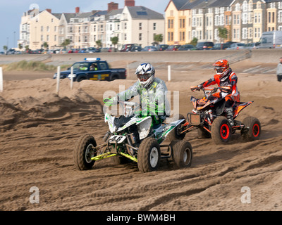 Motocross riders holding a race meeting on a specially constructed course on Barmouth beach Gwynedd North Wales - Stock Photo