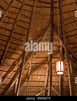 Looking up at the ceiling of the inside a traditionally-constructed great room in Tarangire, Tanzania. - Stock Photo
