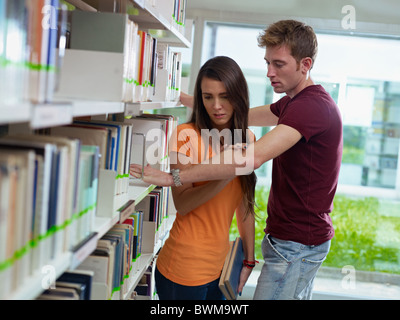 two caucasian students leaving each other. Horizontal shape, side view, waist up - Stock Photo
