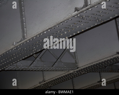 Metal girders and beams on the underside of a bridge - Stock Photo