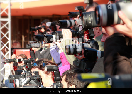 group of photographers photographing film stars at Rome International film festival - Stock Photo