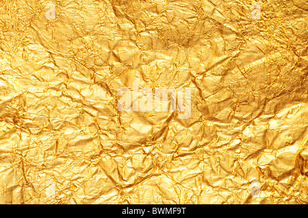 Crumpled gold foil textured background Horizontal - Stock Photo