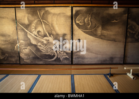 Byobu, literally 'wind wall' are Japanese folding screens made from several joined panels - Stock Photo