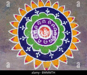 Sacred OM / AUM Rangoli  coloured powder design in an Indian street during a hindu festival. Puttaparthi, Andhra - Stock Photo