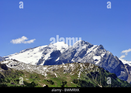 Aerial view of Canazei and Fassa valley with Saas Pordoi mount (Sella group) Pordoi pass and Fedaia pass dolomiti - Stock Photo