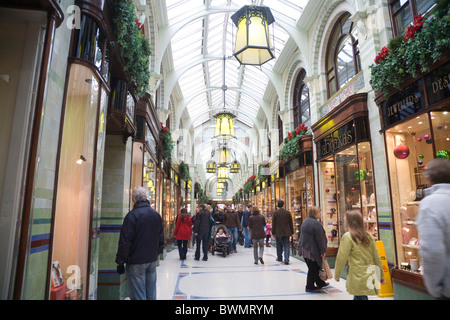 Norwich Norfolk England UK Shoppers in the historic glass covered Royal Arcade opened in 1899 - Stock Photo