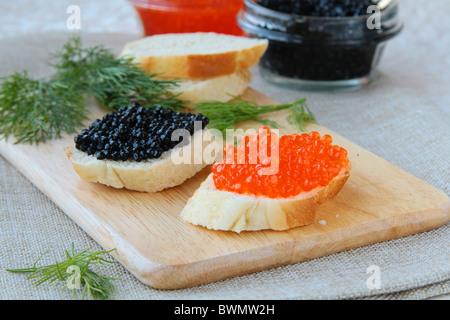 Red and black caviar on sandwiches - Stock Photo